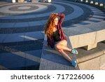 beautiful laughing young girl.... | Shutterstock . vector #717226006