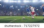 soccer player kicks the ball on ... | Shutterstock . vector #717227572
