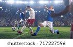 soccer player kicks the ball on ...   Shutterstock . vector #717227596