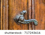 An Old Door Handle With Shape...