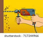 hands drilling wall with rock... | Shutterstock .eps vector #717244966