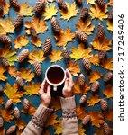 floral autumn background. a mug ... | Shutterstock . vector #717249406