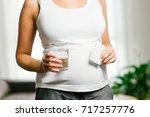 pregnancy healthy concept.... | Shutterstock . vector #717257776