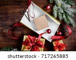 gifts boxes with fir branches... | Shutterstock . vector #717265885