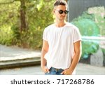 fashion guy posing at sunset in ... | Shutterstock . vector #717268786