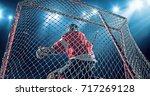 ice hockey goalie saves a goal... | Shutterstock . vector #717269128