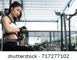 young woman wearing gloves in... | Shutterstock . vector #717277102