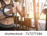 young woman execute exercise... | Shutterstock . vector #717277186