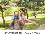 male gay couple with foster son ... | Shutterstock . vector #717277438