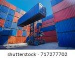 forklift truck lifting cargo... | Shutterstock . vector #717277702