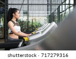young woman execute exercise in ... | Shutterstock . vector #717279316