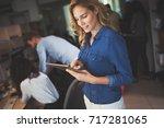 beautiful businesswoman holding ... | Shutterstock . vector #717281065