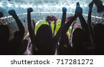 group of fans are cheering for... | Shutterstock . vector #717281272