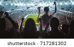 group of fans are cheering for... | Shutterstock . vector #717281302