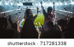 group of fans are cheering for... | Shutterstock . vector #717281338