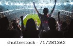 group of fans are cheering for... | Shutterstock . vector #717281362
