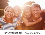 middle aged couple piggybacking ... | Shutterstock . vector #717301792