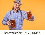 portrait of oktoberfest man ...   Shutterstock . vector #717318346