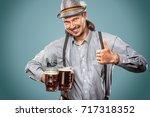 portrait of oktoberfest man ...   Shutterstock . vector #717318352