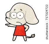 cartoon unsure elephant girl... | Shutterstock .eps vector #717329722