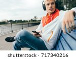 cropped shot of blond young man ... | Shutterstock . vector #717340216