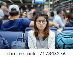 portrait young woman waiting at ... | Shutterstock . vector #717343276