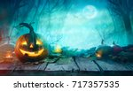 Halloween Pumpkins on wood. Halloween Background At Night Forest with Moon.