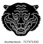 tiger head silhouette vector... | Shutterstock .eps vector #717371332