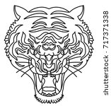 tiger head silhouette vector...   Shutterstock .eps vector #717371338