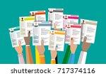 hands holding cv resume... | Shutterstock .eps vector #717374116