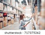stock taking. beautiful young... | Shutterstock . vector #717375262