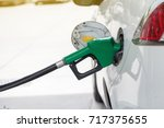 refill and filling oil gas fuel ... | Shutterstock . vector #717375655