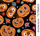 Stock vector vector seamless pattern for halloween pumpkin flowers and spiderweb on the halloween theme bright 717386815
