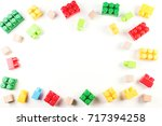 Stock photo toys background colorful wooden cubes and plastic construction blocks frame on white background 717394258