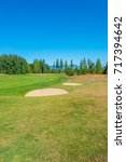 sand bunkers at the golf course. | Shutterstock . vector #717394642