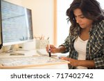 woman on computer desk writing... | Shutterstock . vector #717402742