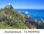 lighthouse  coastline ... | Shutterstock . vector #717405952