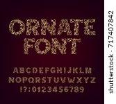 ornate golden typeface.... | Shutterstock .eps vector #717407842