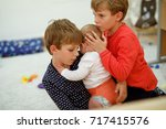 two little kid boys hugging... | Shutterstock . vector #717415576