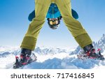 sporty man bending down playing ... | Shutterstock . vector #717416845