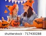 mother and her daughter having... | Shutterstock . vector #717430288