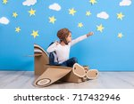little child girl in a pilot's... | Shutterstock . vector #717432946