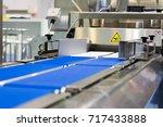 packing line. conveyor... | Shutterstock . vector #717433888
