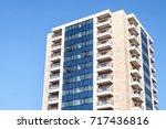 tall building on blue sky... | Shutterstock . vector #717436816