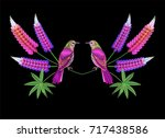 embroidery lupine and bird. | Shutterstock .eps vector #717438586