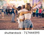 friends hugging on music... | Shutterstock . vector #717444595