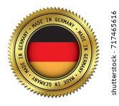 made in germany golden badge... | Shutterstock .eps vector #717465616