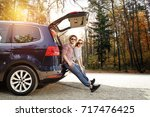 autumn trip of car and two... | Shutterstock . vector #717476425
