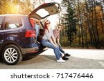 autumn trip of car and two...   Shutterstock . vector #717476446