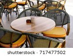chairs and tables in modern cafe | Shutterstock . vector #717477502